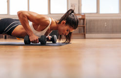 Woman exercising in the gym. Cropped shot of woman exercising in the gym. Muscular female doing core workout on fitness mat with copy space Stock Images