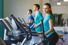Woman exercising at the gym on a cross trainer Royalty Free Stock Image