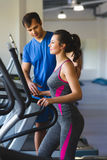 Woman exercising at the gym on a cross trainer Royalty Free Stock Photography