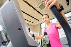 Woman exercising in gym. Healthy lifestyle and sport. Pretty young woman exercising in gym Royalty Free Stock Photo