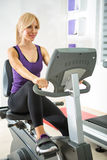Woman exercising in gym. Royalty Free Stock Images