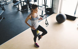 Woman exercising in gym with stretching bands. Sportive woman exercising in gym with stretching bands Stock Image