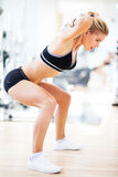 Woman exercising in a gym Stock Image