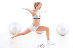 Woman exercising in a gym. Woman working out at a health club Stock Photo
