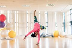 Woman exercising in the gym. Young woman exercising in the gym Stock Image