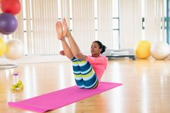 Woman exercising in the gym. Young woman exercising in the gym Stock Photos
