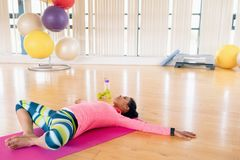 Woman exercising in the gym. Young woman exercising in the gym Royalty Free Stock Photography