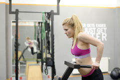 Woman exercising in gym. Young blond woman exercising in gym Stock Photo