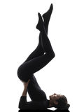 Woman exercising gymnastic salamba sarvangasana Shoulder Stand y Royalty Free Stock Photography