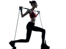 Woman exercising gymstick stock photos