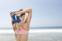 Woman Exercising With Hand Weights Royalty Free Stock Photo