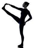 Woman exercising Hasta Padangusthasana hand to big toe pose yoga Royalty Free Stock Images