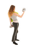 Woman exercising with heavy dumbells Royalty Free Stock Photo