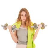 Woman exercising with heavy dumbells Royalty Free Stock Photography