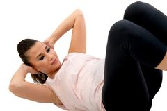 Woman exercising her abs Stock Image