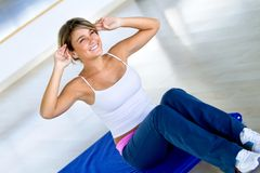 Woman exercising her abs Royalty Free Stock Image
