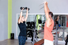 Woman exercising with her personal trainer Royalty Free Stock Image