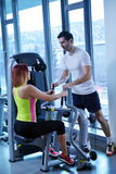 Woman exercising with her personal trainer Stock Photo