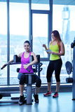 Woman exercising with her personal trainer Royalty Free Stock Photo