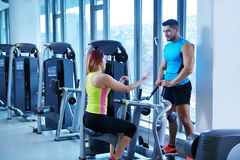 Woman exercising with her personal trainer Stock Photos