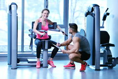 Woman exercising with her personal trainer Stock Photography