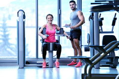 Woman exercising with her personal trainer Royalty Free Stock Images