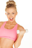 Woman exercising holding a dumbell Stock Images