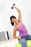 Woman exercising at home Royalty Free Stock Images