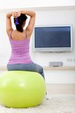 Woman exercising at home Royalty Free Stock Photos
