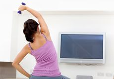 Woman exercising at home Royalty Free Stock Photography