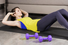 Woman exercising at home Stock Photos