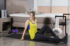 Woman exercising at home Stock Photo
