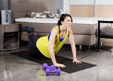 Woman exercising at home Stock Photography