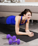 Woman exercising at home Stock Images
