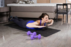 Woman exercising at home Royalty Free Stock Image