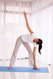 Woman exercising indoors Stock Images