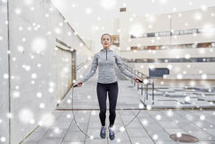 Woman exercising with jump-rope outdoors Stock Photos