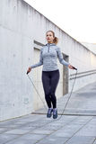 Woman exercising with jump-rope outdoors Royalty Free Stock Photography