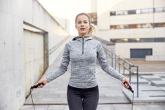 Woman exercising with jump-rope outdoors Royalty Free Stock Photos