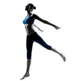 Woman exercising jumping stretching dancing Stock Photos
