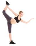 Woman exercising jumping stretching dancing Royalty Free Stock Photos