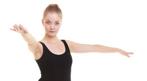 Woman exercising jumping stretching dancing Stock Images