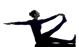 Woman exercising Krounchasana heron pose yoga silhouette Royalty Free Stock Image