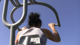 Woman exercising on a machine stock footage