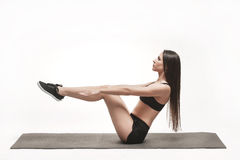 Woman exercising on man Royalty Free Stock Photography