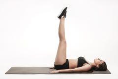 Woman exercising on man Royalty Free Stock Photos
