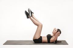 Woman exercising on man Stock Photos