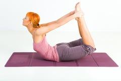 Woman exercising on mat Royalty Free Stock Photo