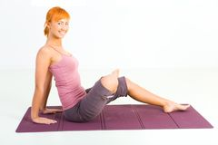 Woman exercising on mat Royalty Free Stock Photos