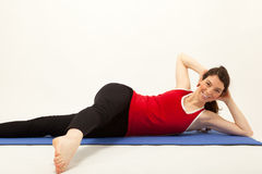 The woman is exercising on a mat Stock Photos